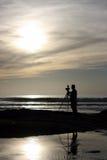 Silhouette de photographe d'océan Photographie stock libre de droits