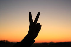 Silhouette de signe de main Photos stock