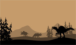 Silhouette de spinosaurus et de Triceratops Photo stock