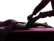 Silhouette de thérapie de massage de jambes Images stock