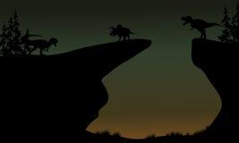 Silhouette de Triceratops et d'Allosaurus Photographie stock
