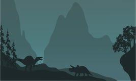 Silhouette de triceratops et de spinosaurus Photo libre de droits
