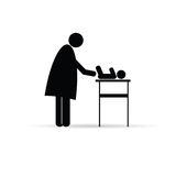 Silhouette de vecteur de bébé de changement de mère Photographie stock