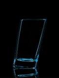 Silhouette de verre bleu pour le tir avec le chemin de coupure sur le fond noir Photographie stock libre de droits