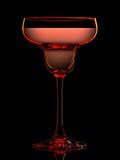 Silhouette de verre coloré de margarita sur le noir Images stock