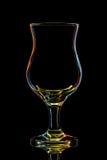Silhouette de verre de cocktail coloré avec le chemin de coupure sur le fond noir Images libres de droits