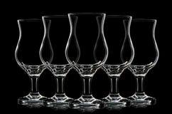 Silhouette de verre de cocktail sur le fond noir Images libres de droits