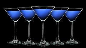 Silhouette de verre de martini de couleur sur le noir Images libres de droits