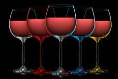 Silhouette de verre de vin de couleur sur le noir Photographie stock