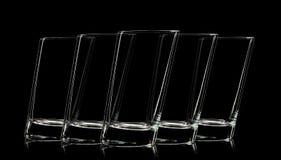 Silhouette de verre pour le tir sur le fond noir Image stock