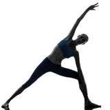 Silhouette de yoga de pose de porte de parighasana de femme Photo libre de droits