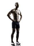 Silhouette debout de jeune homme musculaire sans chemise africain de construction image stock