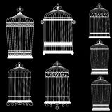 Silhouette of a decorative bird cages set. On black Royalty Free Stock Images