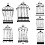 Silhouette of a decorative bird cages set. On white Stock Photography