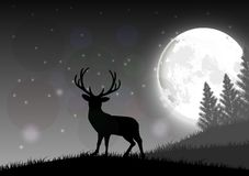 Silhouette of a deer standing on a hill at night with moon Royalty Free Stock Photo