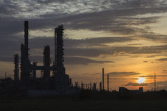 Silhouette depth  of field the Oil Refinery with steam at Sunrise Stock Images