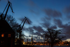 Silhouette of derricks in Hamburg Port. During blue hour directly after dusk Stock Image