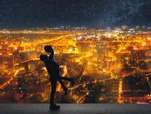 Silhouette des couples asiatiques Photographie stock libre de droits