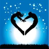 Silhouette des couples en FO Image stock