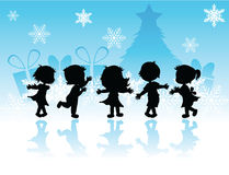 Silhouette des enfants de Noël Photo libre de droits
