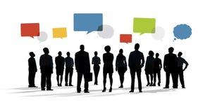 Silhouette des gens d'affaires avec des bulles de la parole Image libre de droits