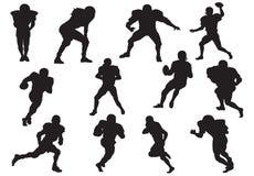 Silhouette des joueurs de football photographie stock libre de droits