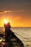 Silhouette des pêcheurs photographie stock libre de droits
