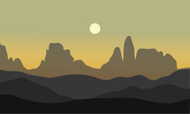 Silhouette of desert with moon Stock Photography