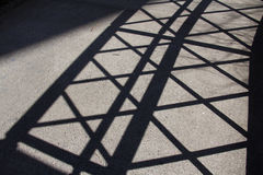 Silhouette diagonal fence. Silhouette of diagonal fence on the concrete ground Stock Images