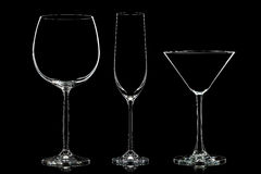 Silhouette of different glasses on black Royalty Free Stock Photography