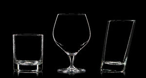 Silhouette of different glasses on black Stock Photography