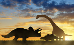Silhouette of dinosaurs. In the sunset Royalty Free Stock Images