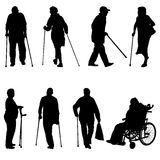 Silhouette of disabled people on a white Stock Photo