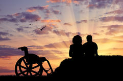 Silhouette of disabled person with the guardian Royalty Free Stock Image