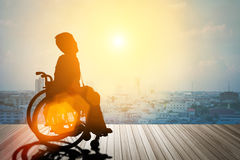 Silhouette of disabled on wheelchair. Royalty Free Stock Photo