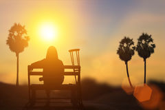 Silhouette of disabled on wheelchair or background. Royalty Free Stock Photography