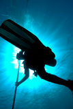 Silhouette of a diver Stock Images