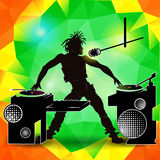 Silhouette of a DJ at a party on a color Royalty Free Stock Image