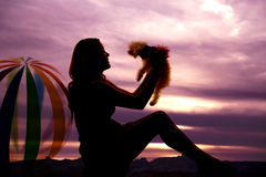 Silhouette dog beach ball Royalty Free Stock Images