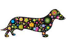 A silhouette of a dog with flowers and stars