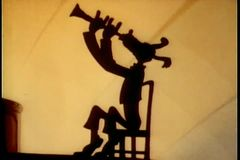 Silhouette of dog playing the clarinet