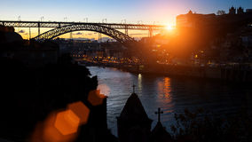 Silhouette of Dom Luis I Bridge over Douro river during amazing sunset. Stock Photography