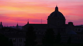 Silhouette dome, sunset in rome, italy, timelapse, zoom out, 4k stock video