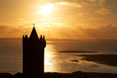 Silhouette of Doonagore castle. At sunset - Ireland Stock Images