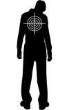 Silhouette of downcast man with target on his back Stock Photography