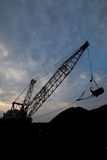 Silhouete of drag line working on mine with beautiful skies Royalty Free Stock Images