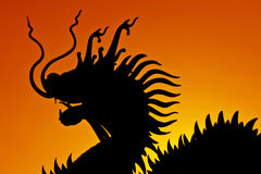 Silhouette of dragon statue Royalty Free Stock Photography