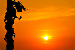 Silhouette of dragon statue Stock Photos
