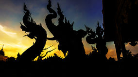 Silhouette dragon statue against twilight sky Stock Image
