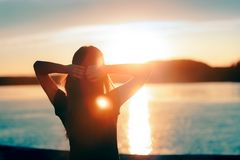 Happy Hopeful Woman Looking at the Sunset by the Sea Royalty Free Stock Photos